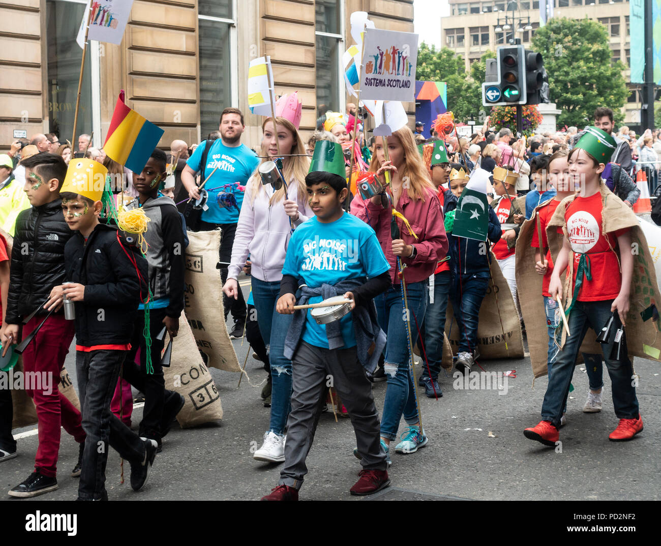 Children from Big Noise, Sistema Scotland, in the Carnival Procession of the Merchant City Festival: part of Festival 2018, Glasgow - Stock Image