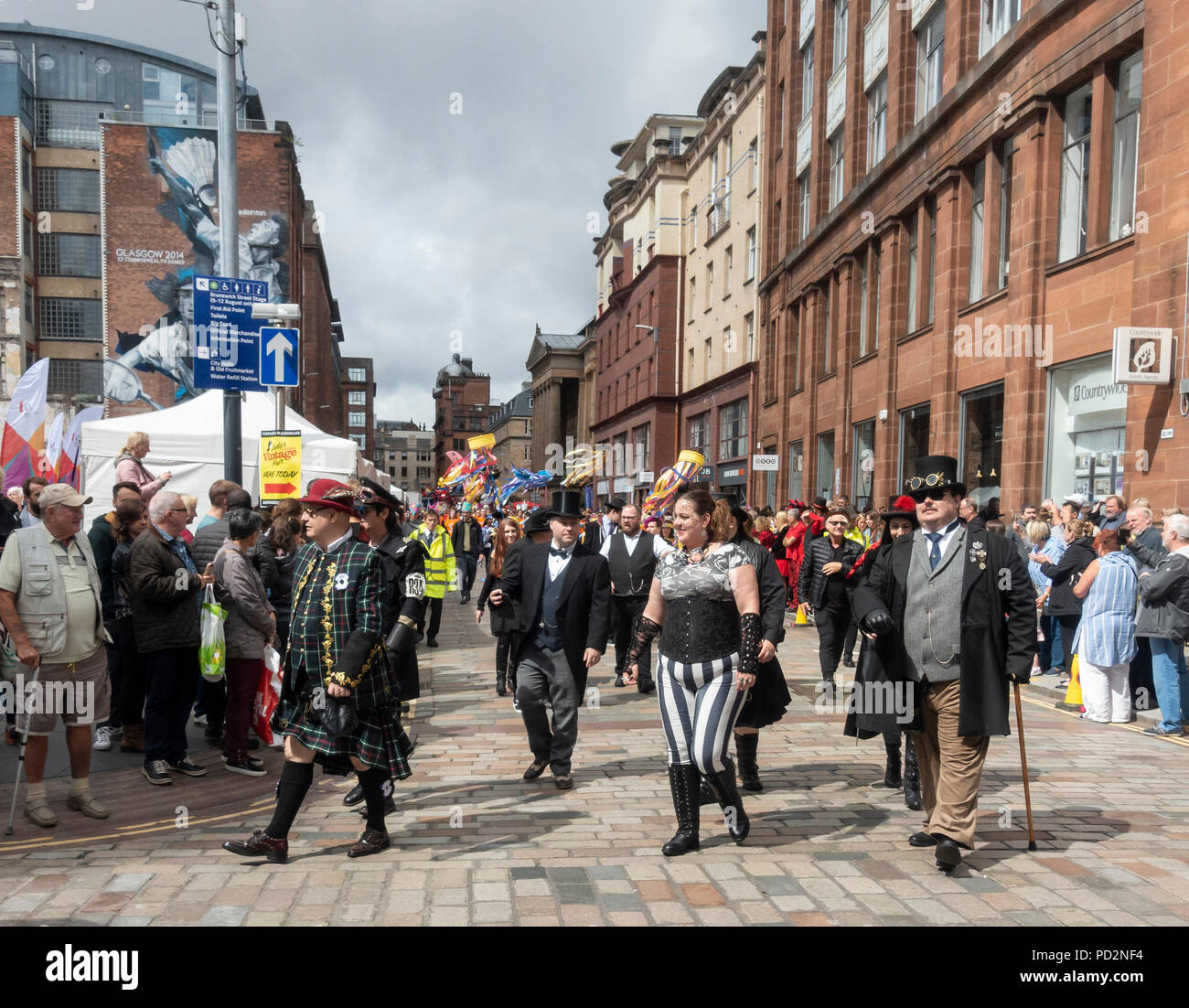 Steampunk fans in full costume in the Carnival Procession of the Merchant City Festival: part of Festival 2018 - Stock Image