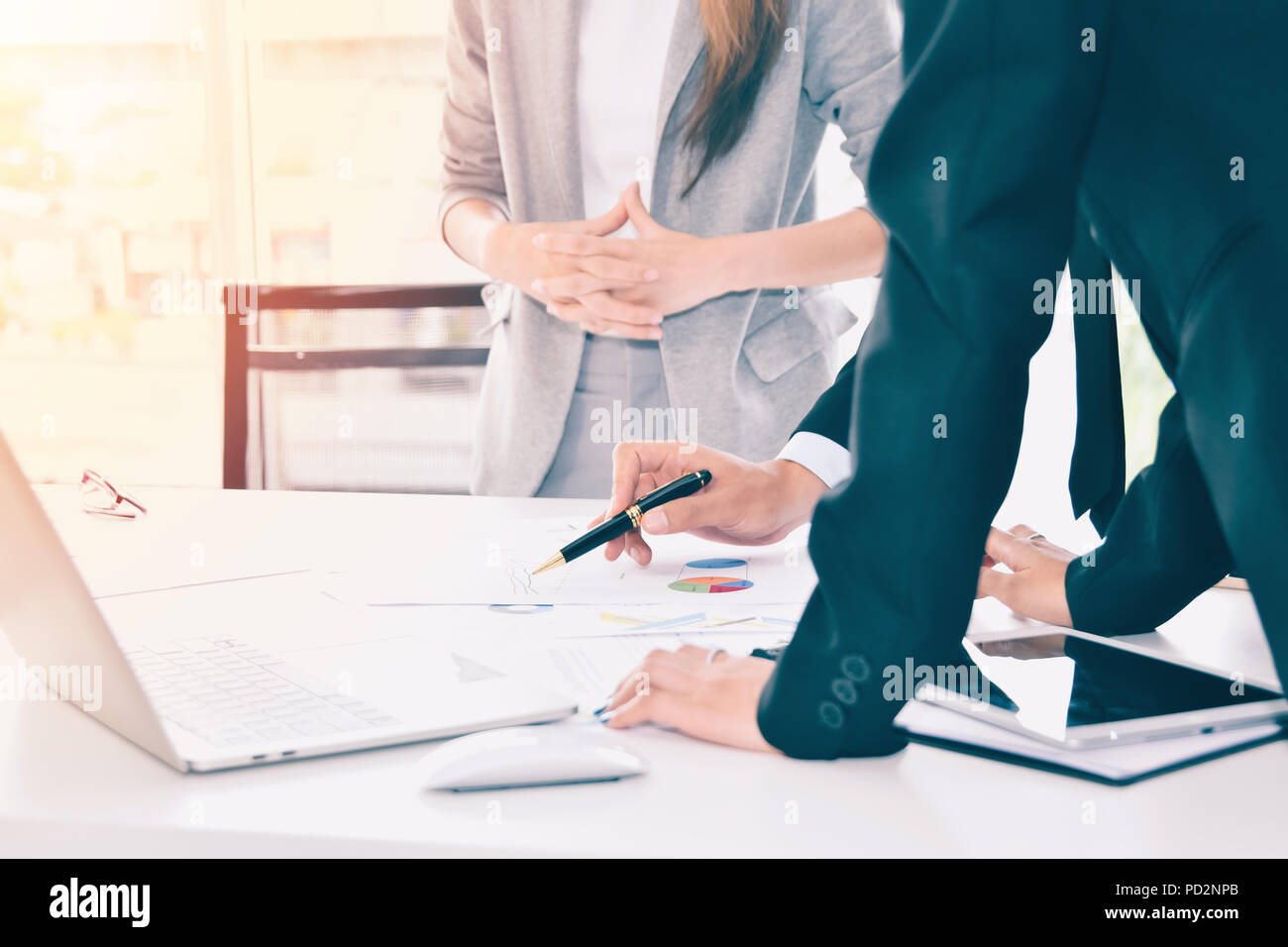 Business people discussing the charts and graphs :business team brainstorm concept - Stock Image