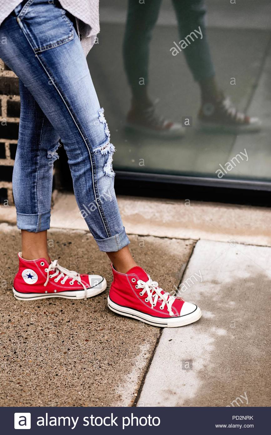 4d4cebcedb6ed Legs and feet with red Converse sneakers Stock Photo  214575975 - Alamy