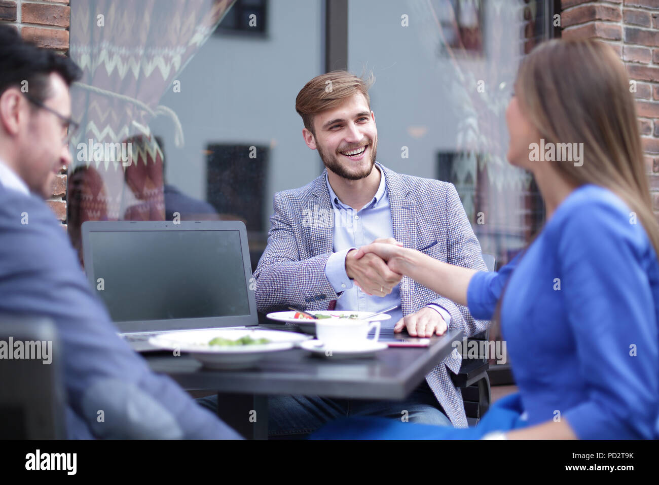 business woman and businessman shaking hands - Stock Image