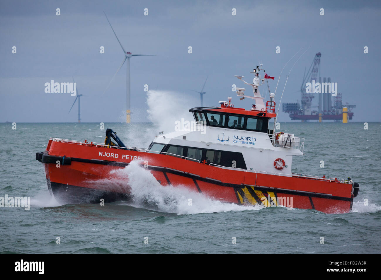 The crew transfer vessel, Njord Petrel working on the Walney Extension Offshore Wind Farm - Stock Image