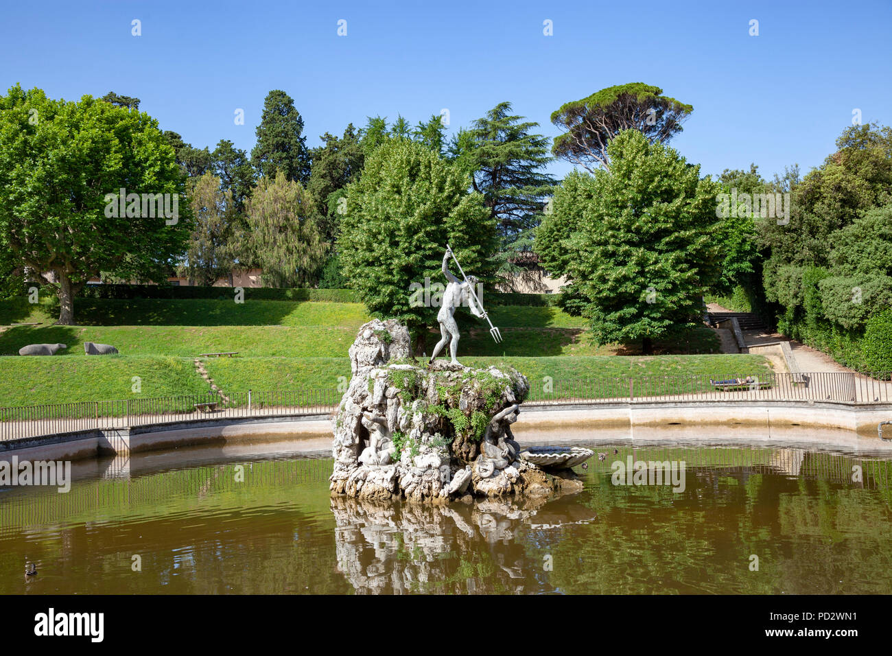 The 'Fountain of Neptune' century XVI th, in the gardens of Boboli at Florence. It is embellished with a bronze statue of the God armed of a trident. - Stock Image