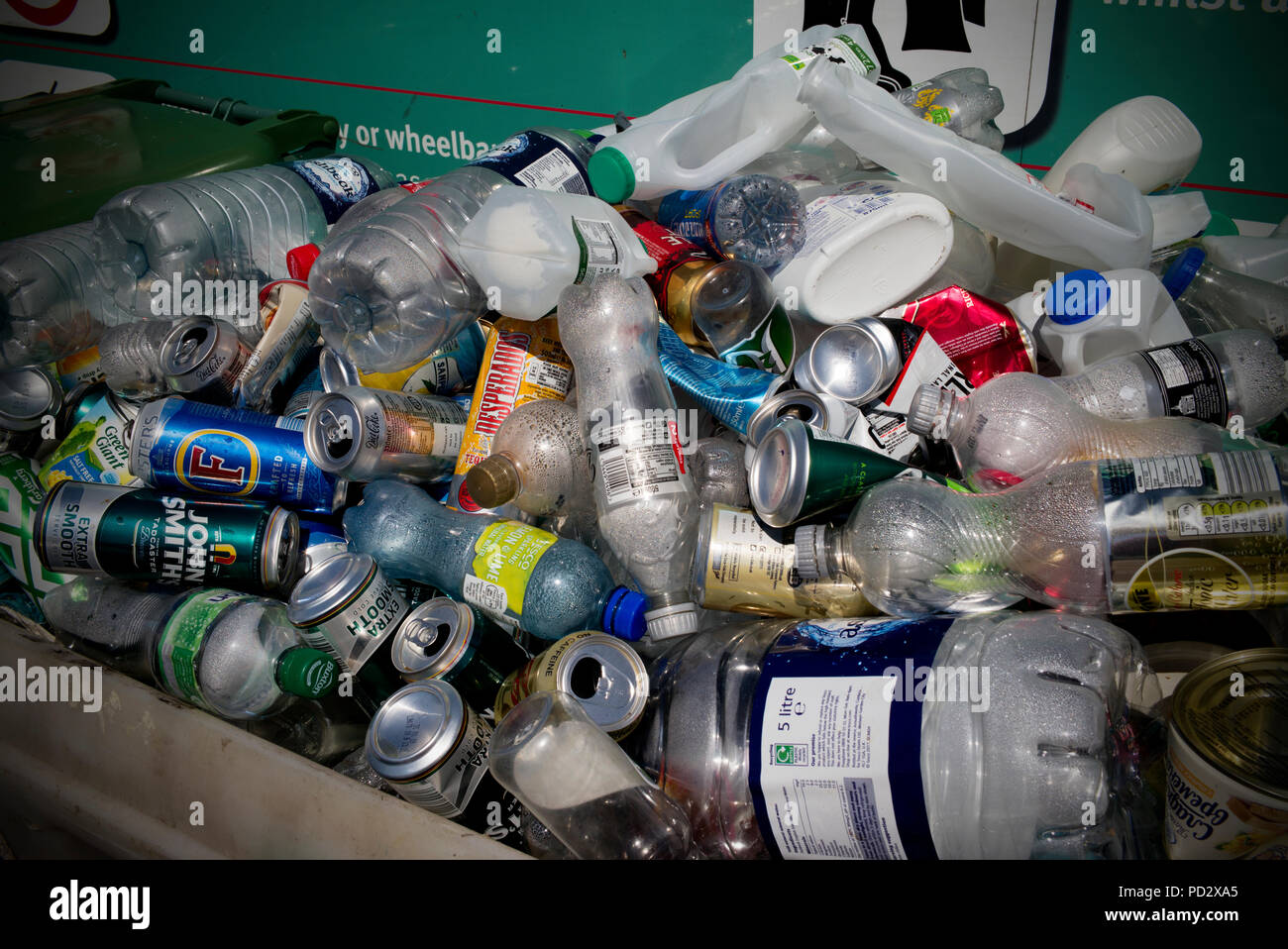 Plastic Bottles and Tins at recycling centre, Saffron Walden Essex England UK. August 2018 - Stock Image