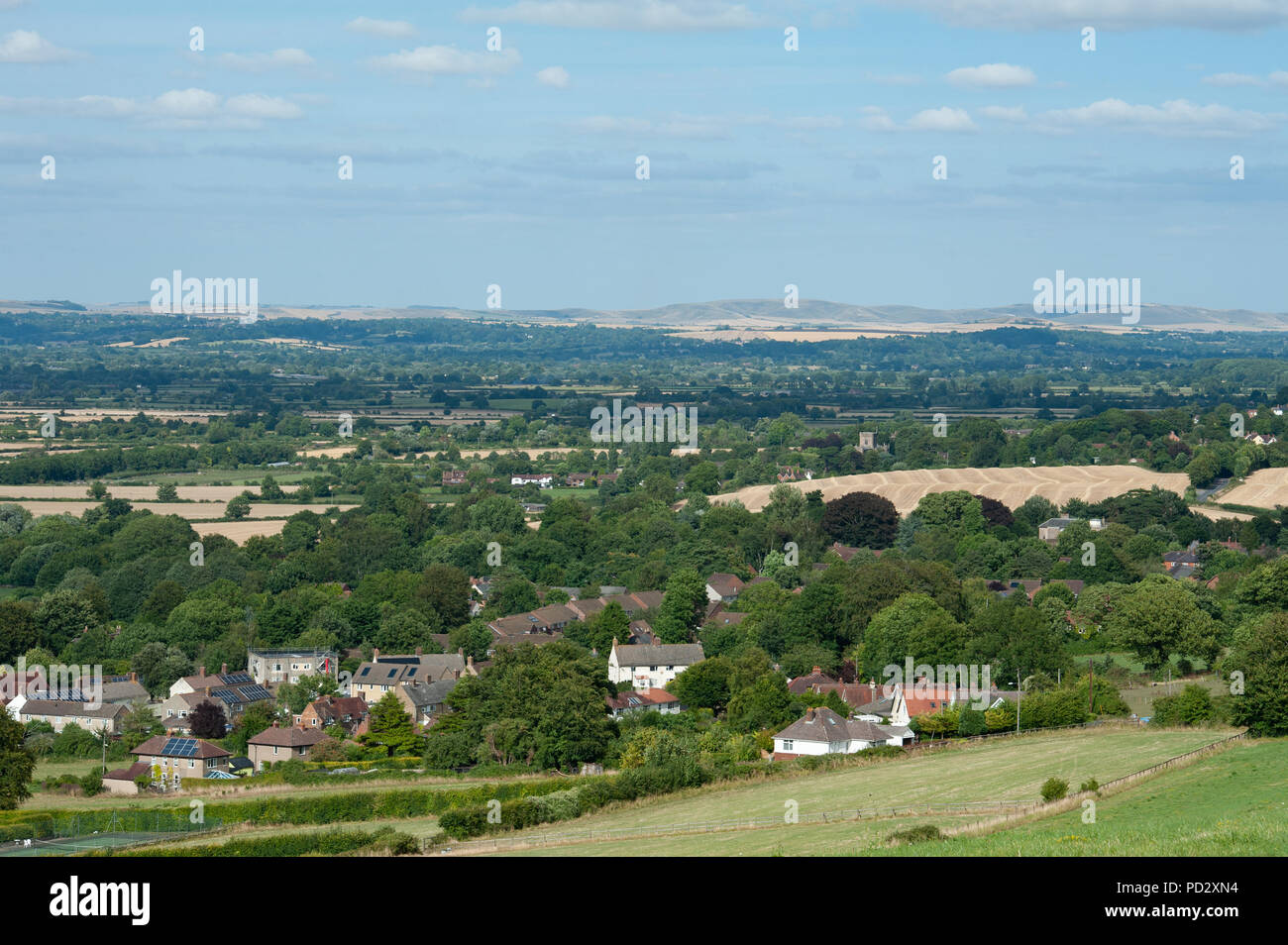 View from Bratton Camp, a Hill Fort, across the rooftops of Bratton, Wiltshire, UK looking North East towards Devizes. Stock Photo