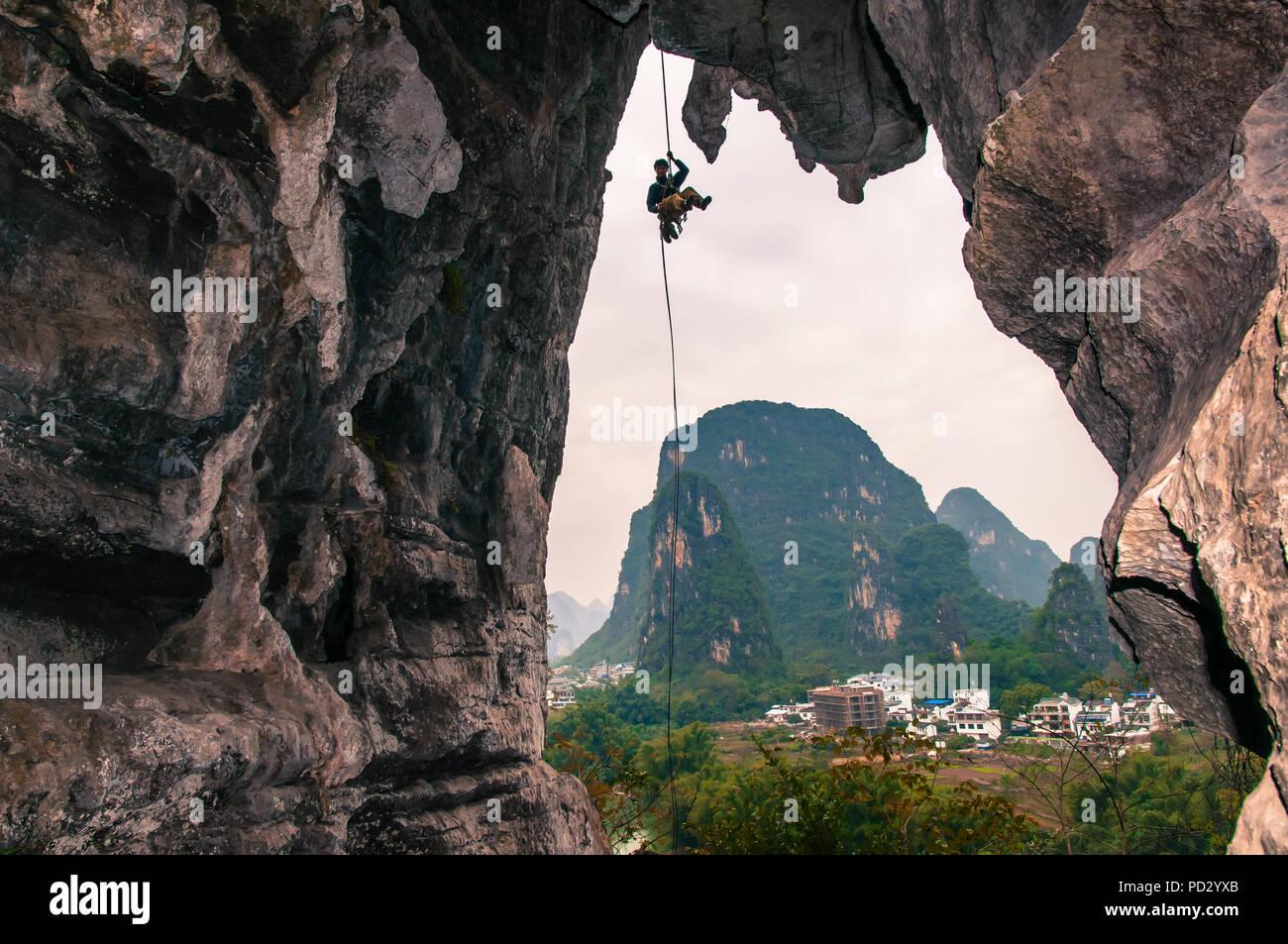 Sport climbing on limestone, in Yangshuo, Guangxi, China - Stock Image