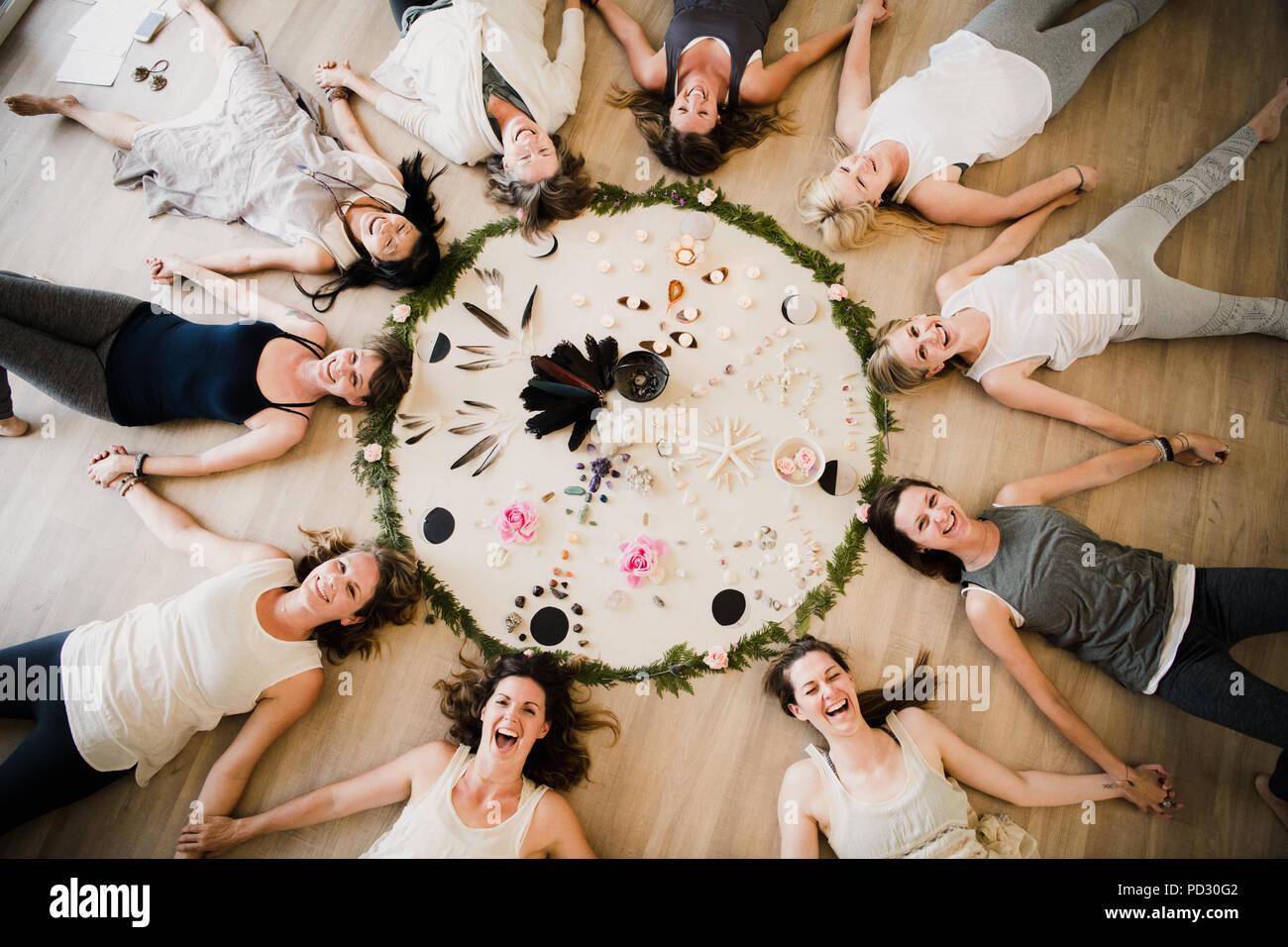Women around circle in yoga retreat - Stock Image