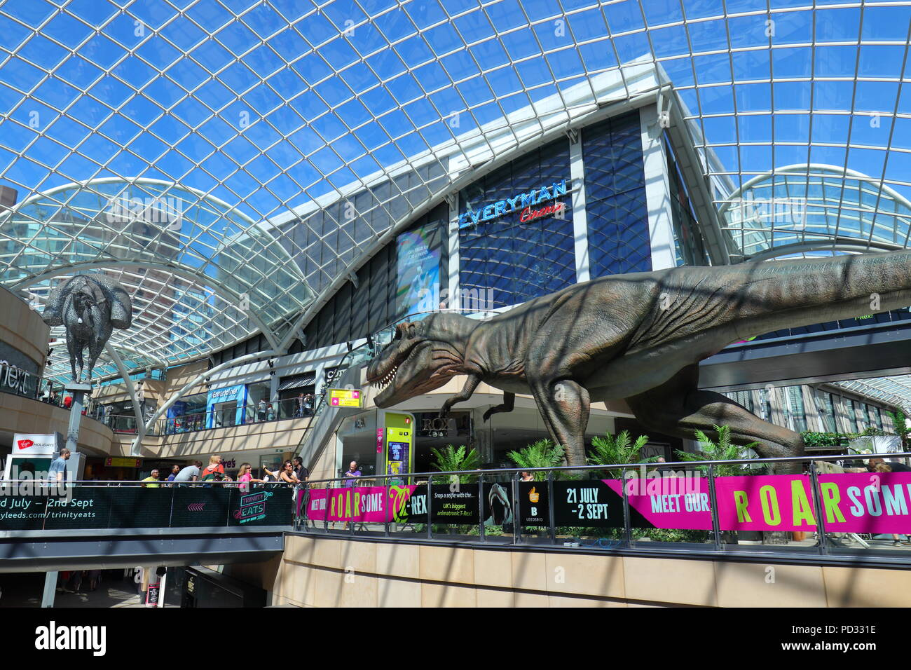 A life size Tyrannosaurus Rex has been installed in the Trinity Leeds Shopping Centre for visitors and customers to admire and take selfies. - Stock Image