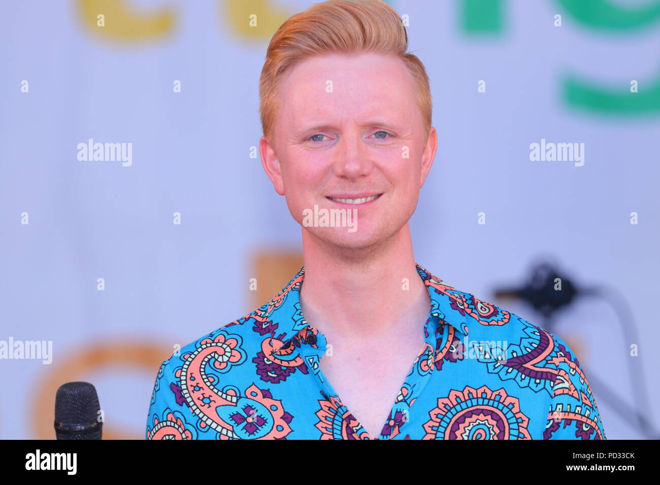 BBc weatherman Owain Wyn Evans hosting the Leeds LGBT Pride event at Millennium Square in the city centre. - Stock Image