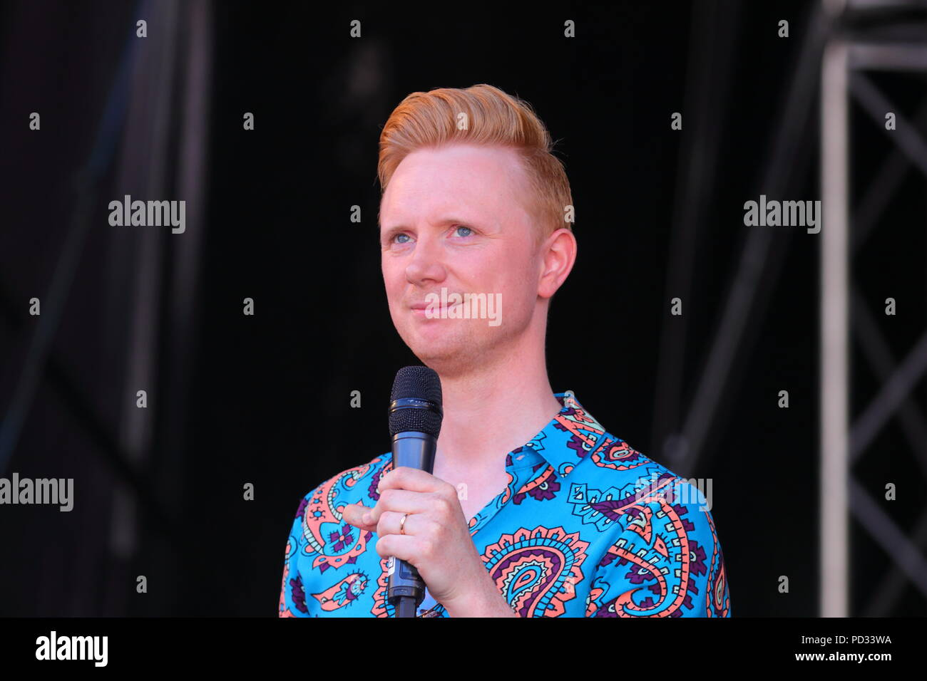 Owain Wyn Evans hosting the Leeds LGBT Pride 2018 on stage at Millennium Square in Leeds - Stock Image
