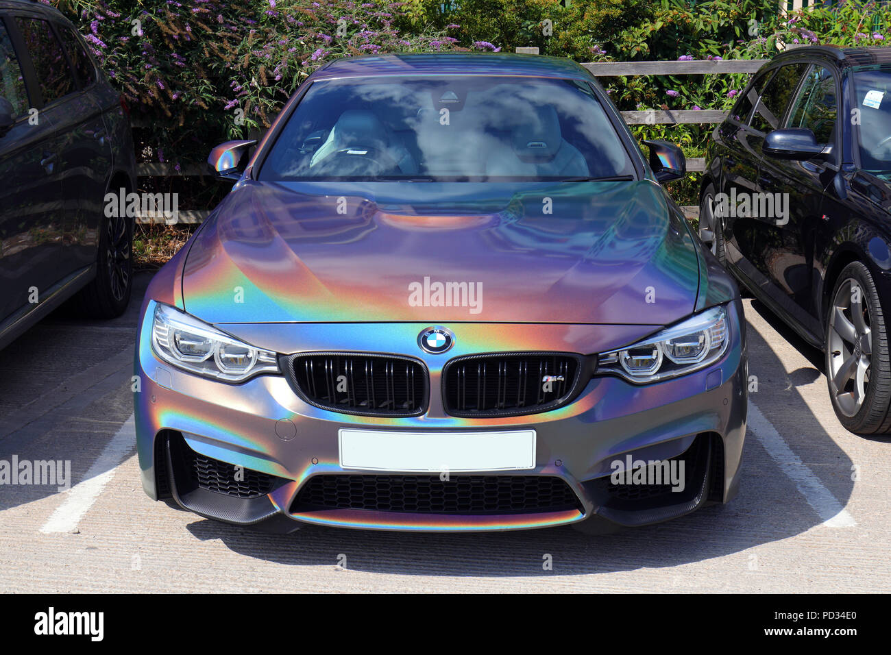 A Bmw With A Holographic Like Paint Work That Changes As You Move Around Stock Photo Alamy
