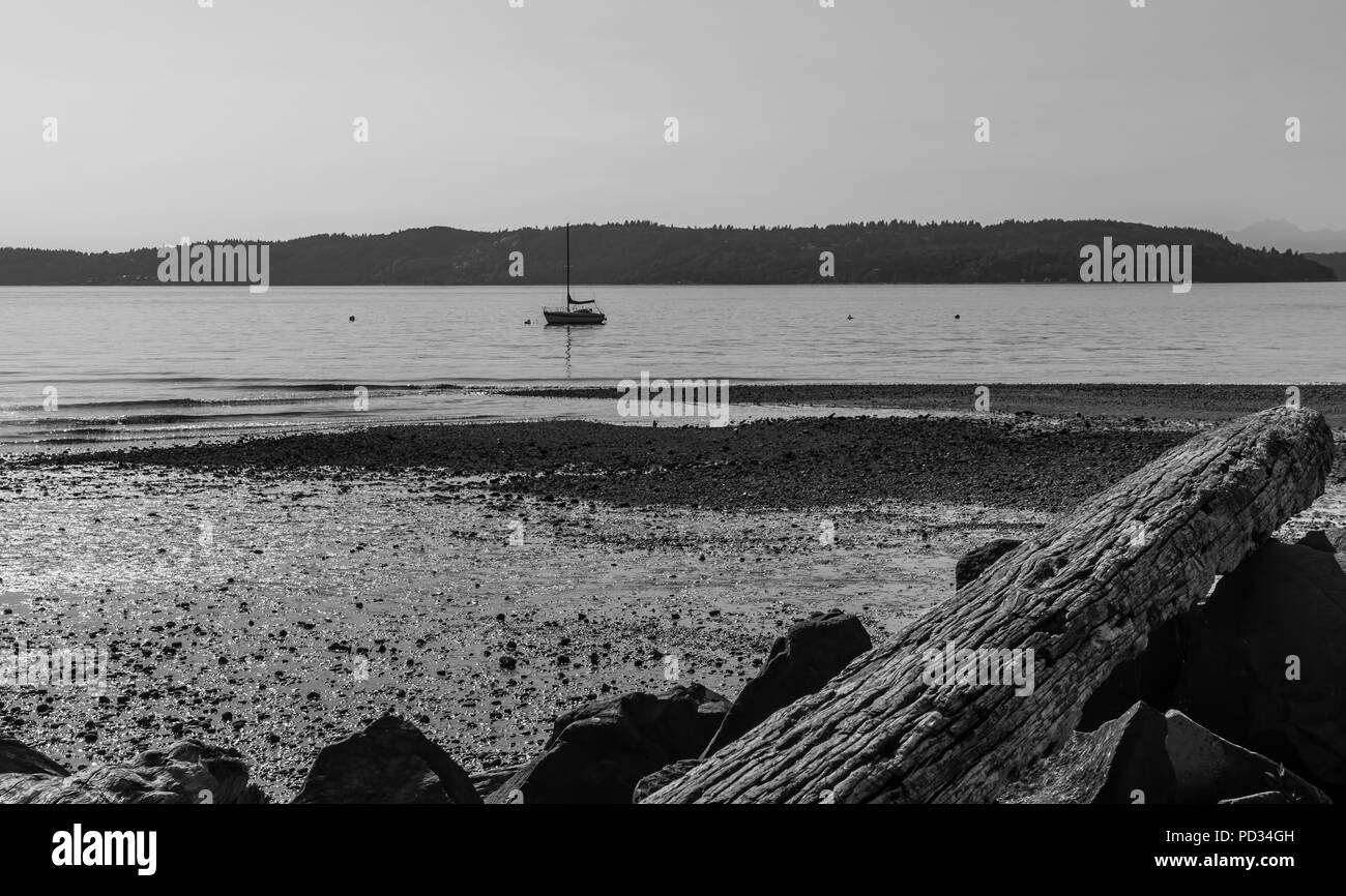A bost floats on the Puget Sound in Des Moines, Washington. - Stock Image