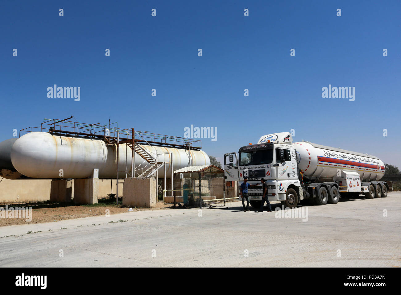 Rafah, Gaza Strip, Palestinian Territory. 6th Aug, 2018. Trucks loaded with  cooking gas imported from Egypt are seen at a gas station in Rafah, ...