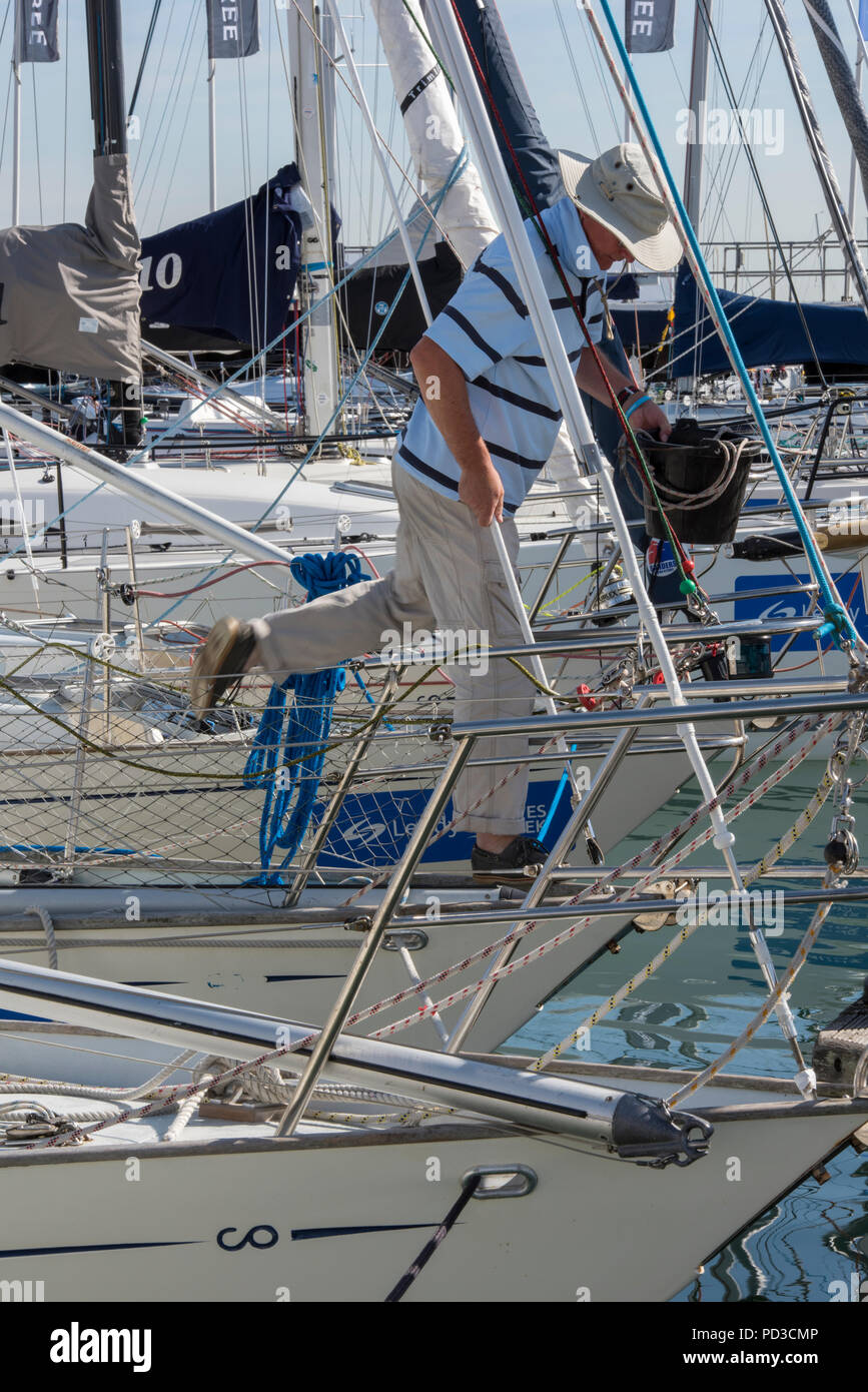 Cowes, Isle of Wight, UK. 6th August, 2018. Crews and spectators at the Cowes week annual sailing regatta on the Isle of Wight enjoying the beautiful weather. Racing postponed until after lunch at the regatta due to a lack of wind but racing resumed after lunch with a sea breeze allowing the yachts to race and enjoy the spectacle. Light airs producing challenging sailing condition for the biggest participant sailing regatta in the world. Sailors and spectators all enjoying the Cowes week experience. Credit: Steve Hawkins Photography/Alamy Live News - Stock Image