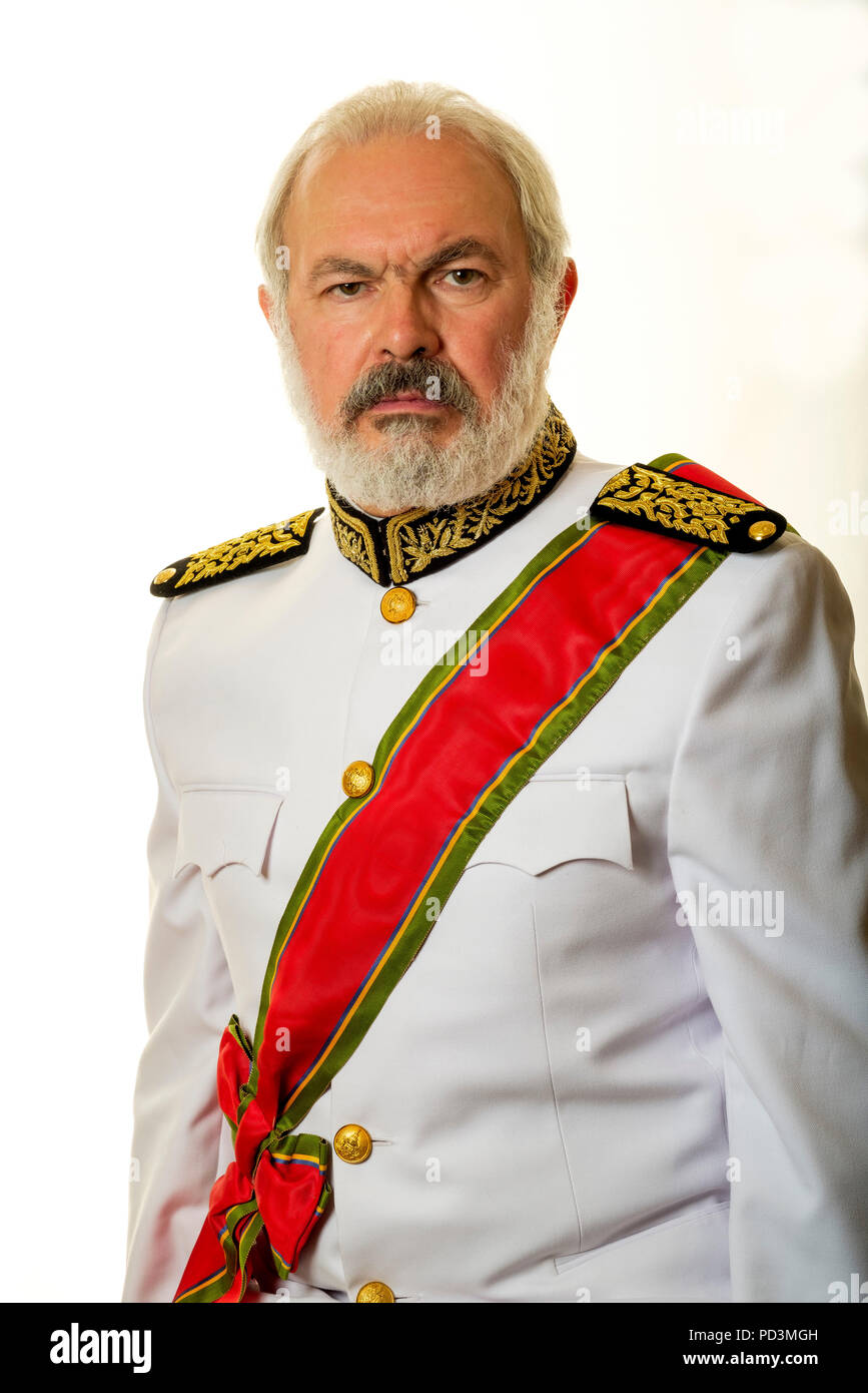 Fictional character : Governor Babala with white full uniform and red honorific sash, - Stock Image