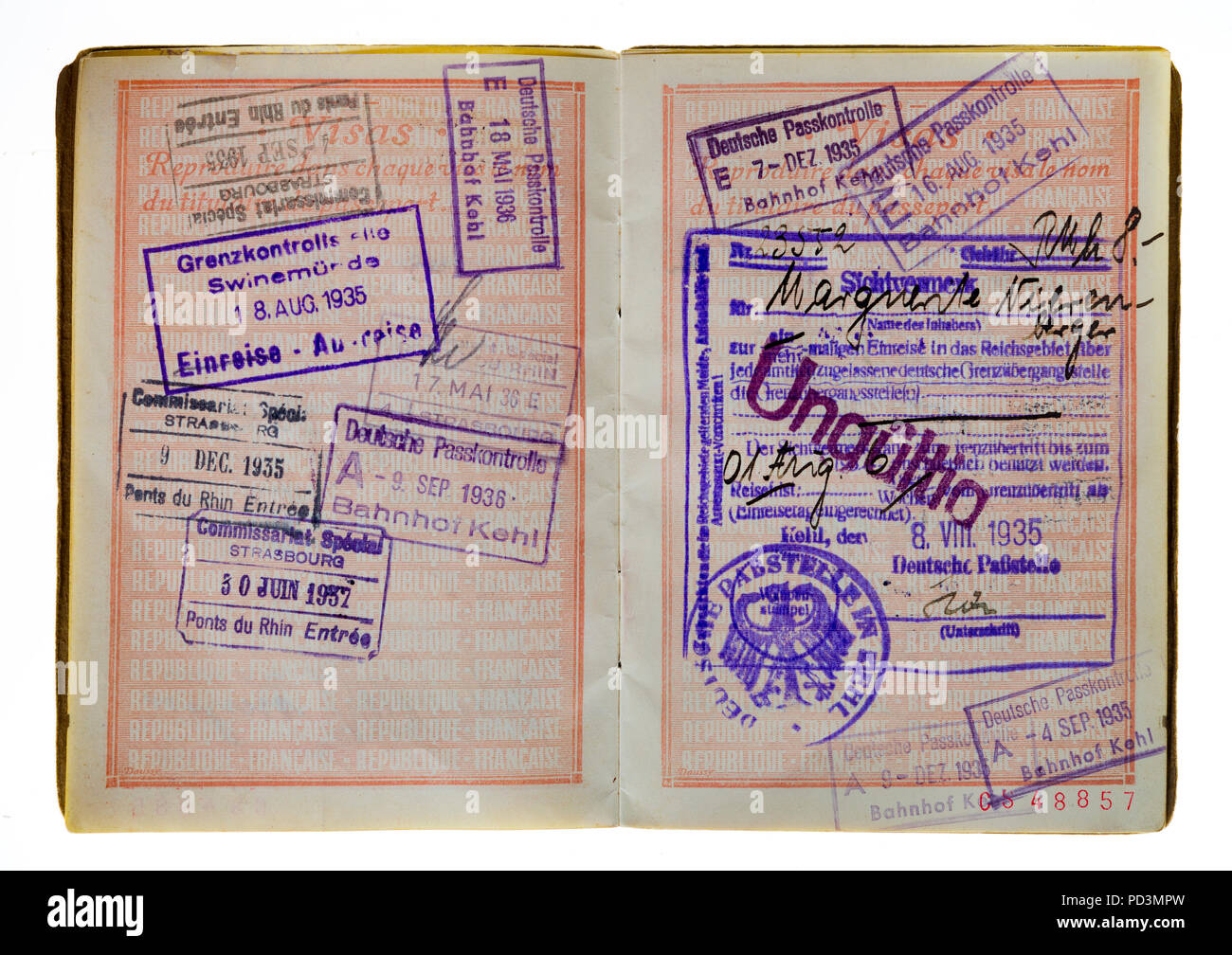 1935's vintage French passport, pages with French and German 1936 and 1937 visas stamps marks, - Stock Image