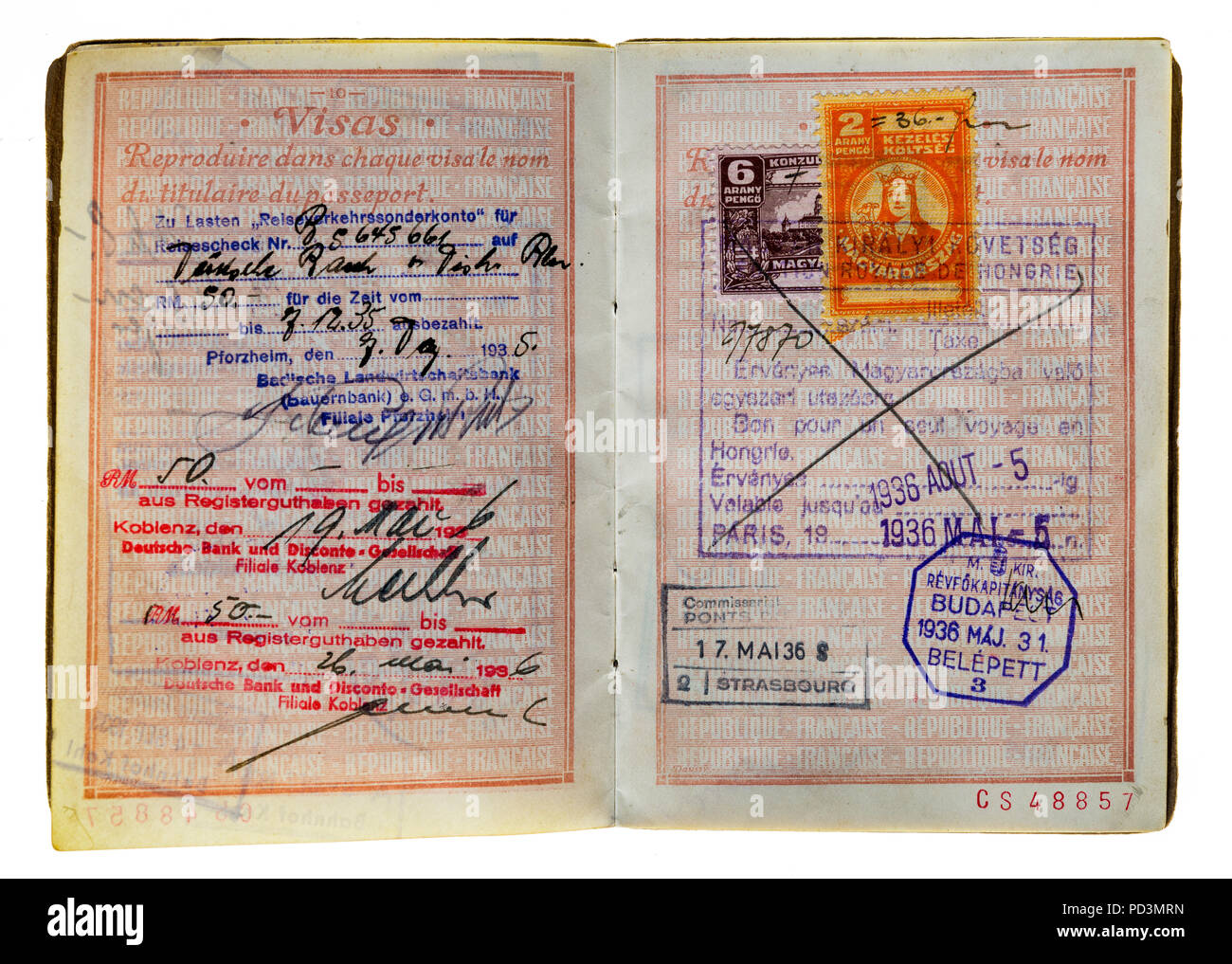 1935's vintage French passport, pages with German and Hungarian 1936 visas stamps marks, Stock Photo