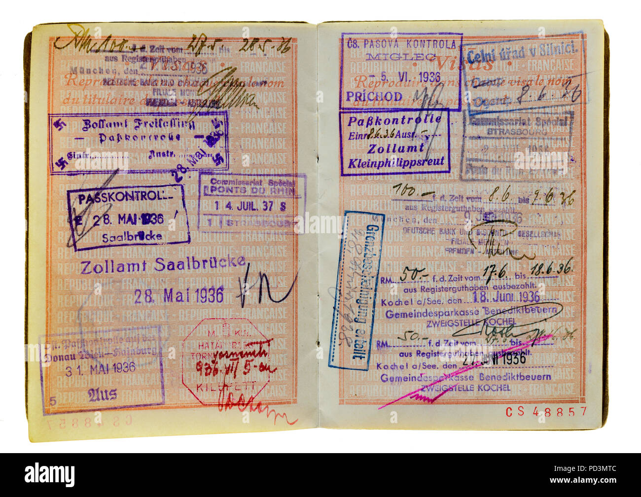 1935's vintage French passport, pages with 1936 German and Austrian visas stamps marks, Stock Photo
