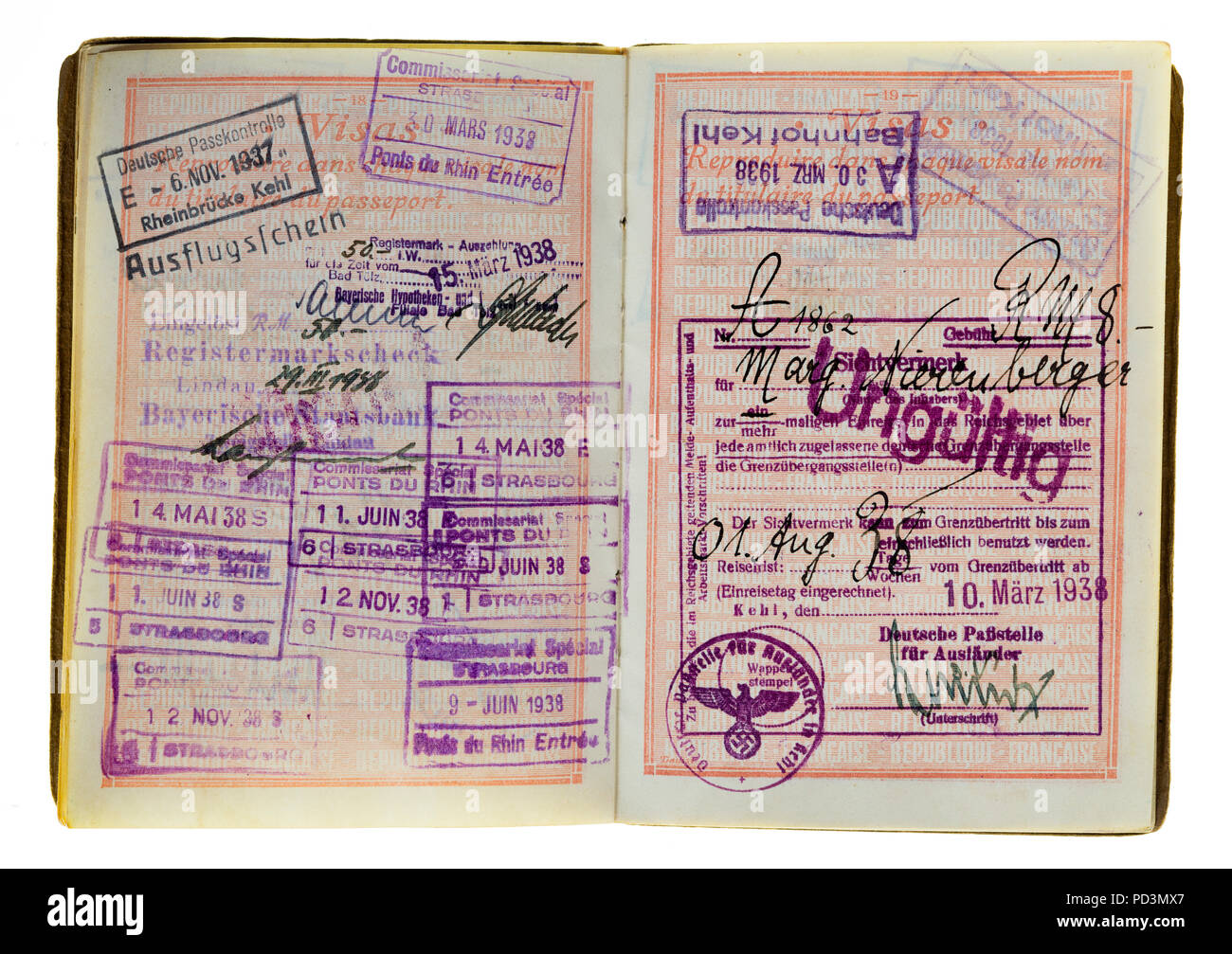 1935's vintage French passport, pages with 1937, 1938 German and French visas stamps marks, - Stock Image