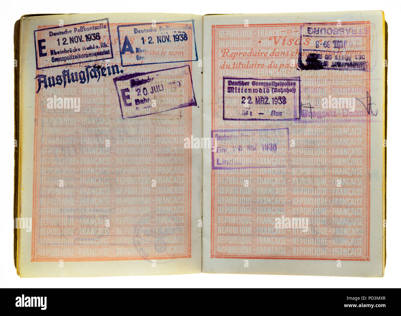 1935's vintage French passport, pages with 1938 German visas stamps marks, - Stock Image
