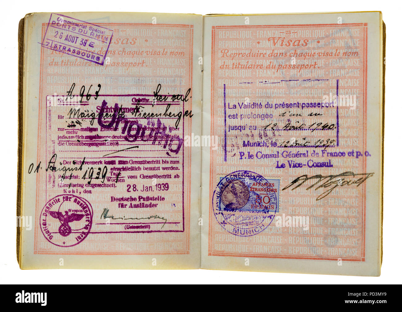 1935's vintage French passport, pages with 1939 German visas stamps marks and renewal date from August 12 1939 until August 12 1940, - Stock Image