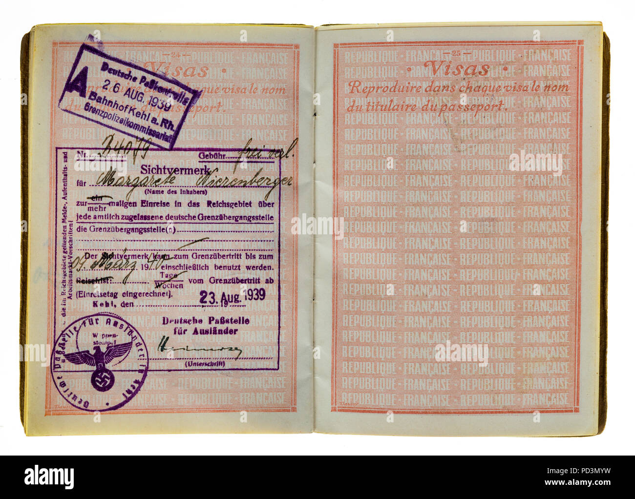 1935's vintage French passport, page with August 23 1939 German visas stamps marks, Stock Photo