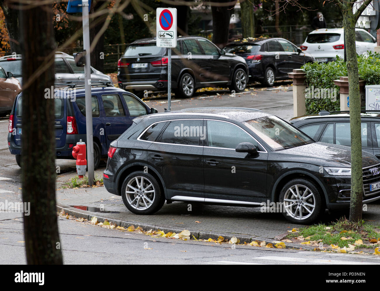 Car parked on pavement, Strasbourg, Alsace, France, Europe, - Stock Image