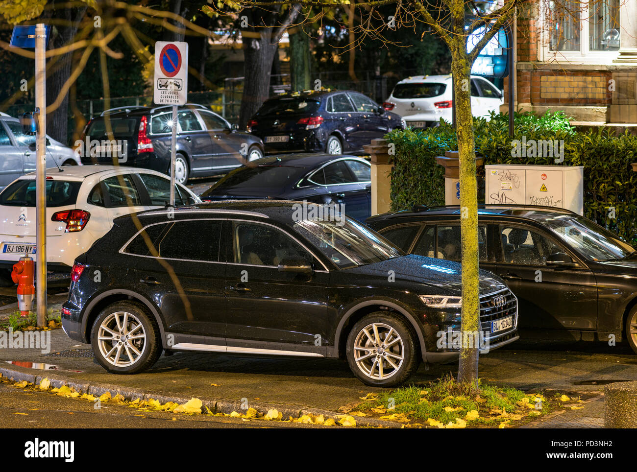 Cars parked on pavement at night, Strasbourg, Alsace, France, Europe, - Stock Image