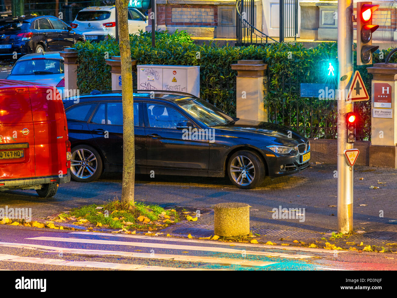 Cars parked on pavement at night, pedestrian crossing, traffic lights, Strasbourg, Alsace, France, Europe, - Stock Image