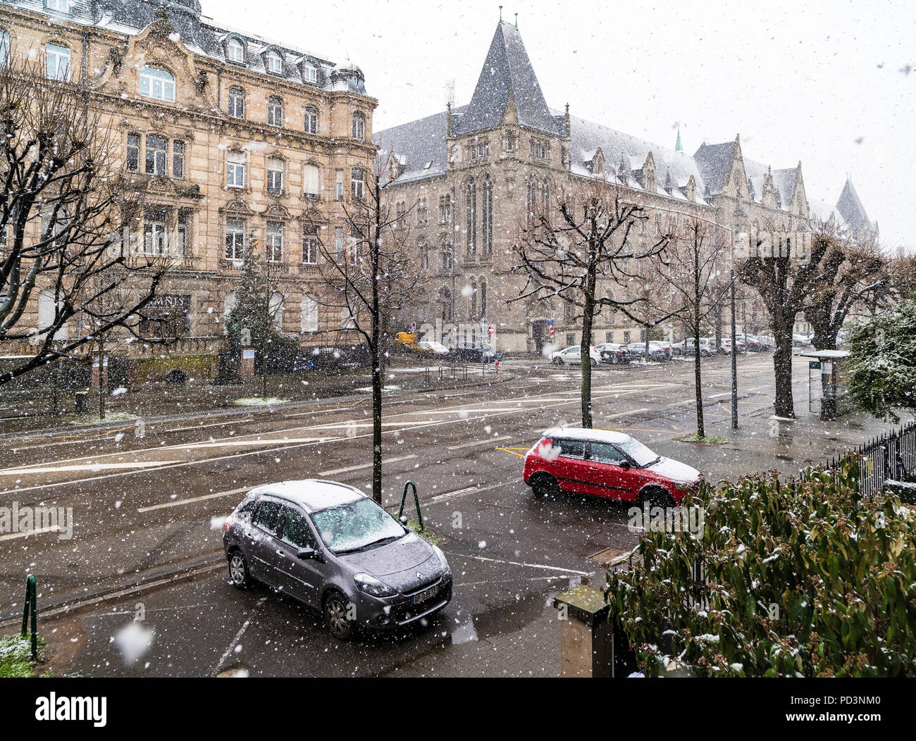 Cars parked on pavement, snow storm, Strasbourg, Alsace, France, Europe, - Stock Image