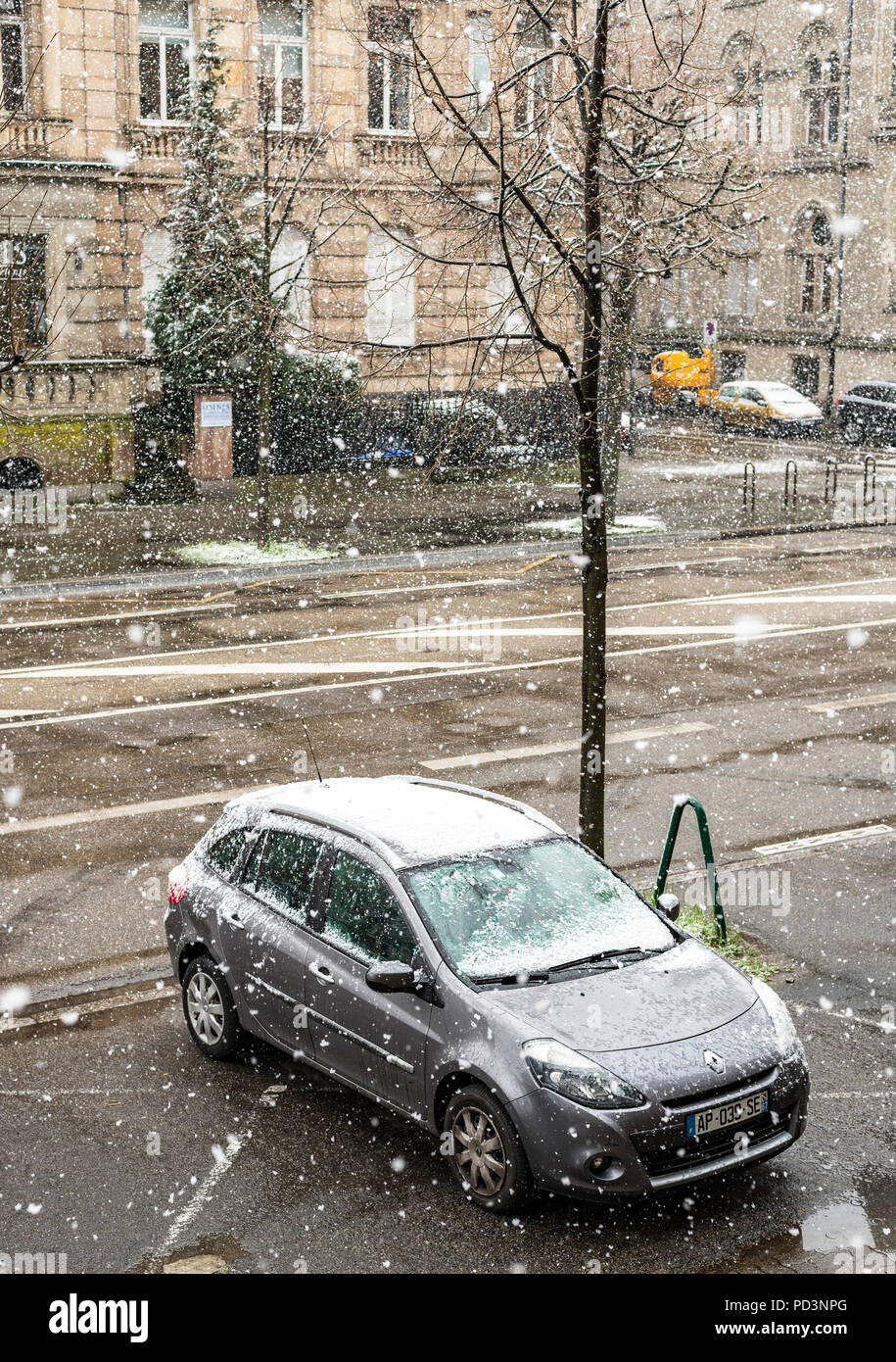 Car parked on pavement, snow storm, Strasbourg, Alsace, France, Europe, - Stock Image