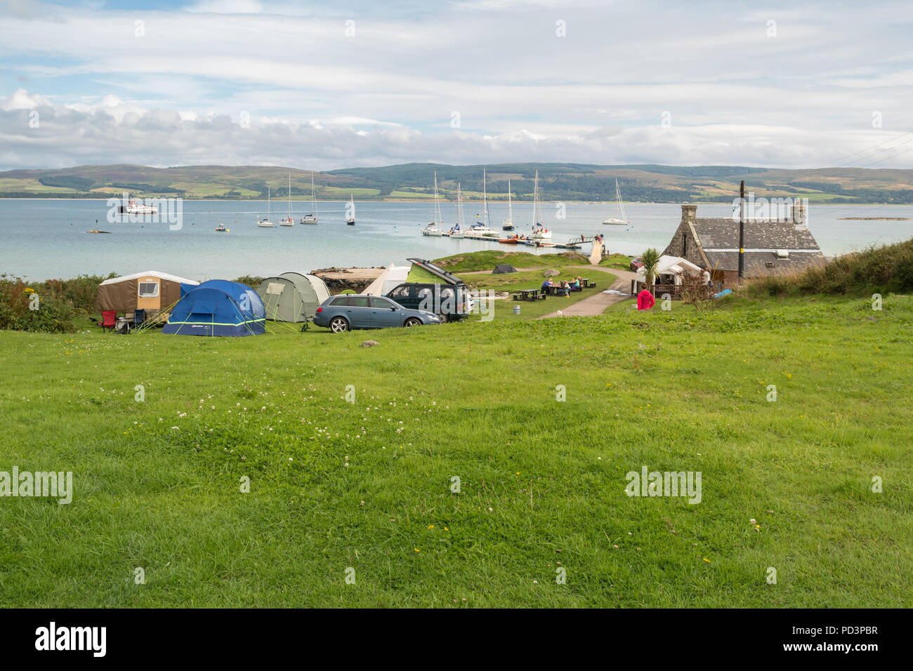 Gigha Moorings, pontoon, campsite and The Boathouse at Ardminish Bay, Isle of Gigha, Scotland, UK - Stock Image