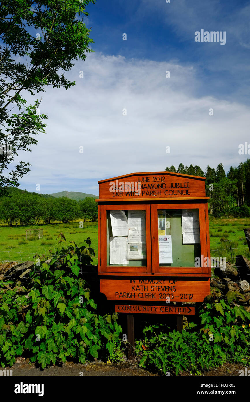 Traditional wooden noticeboard for Skelwith Parish Council in the Lake District - Stock Image
