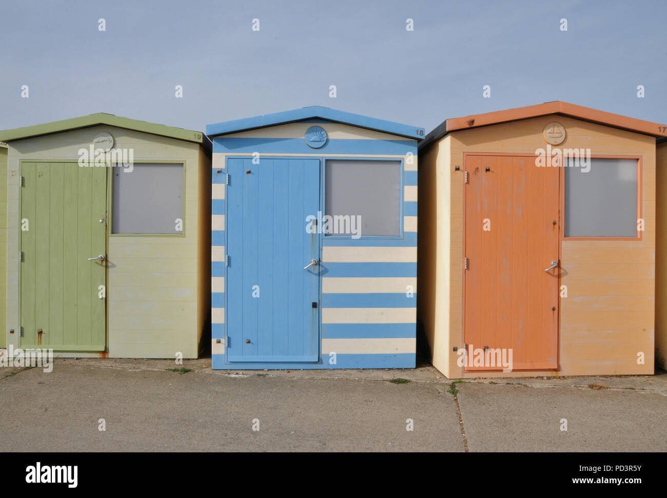 Beach huts on the Sussex coast, Seaford, East Sussex, UK. - Stock Image