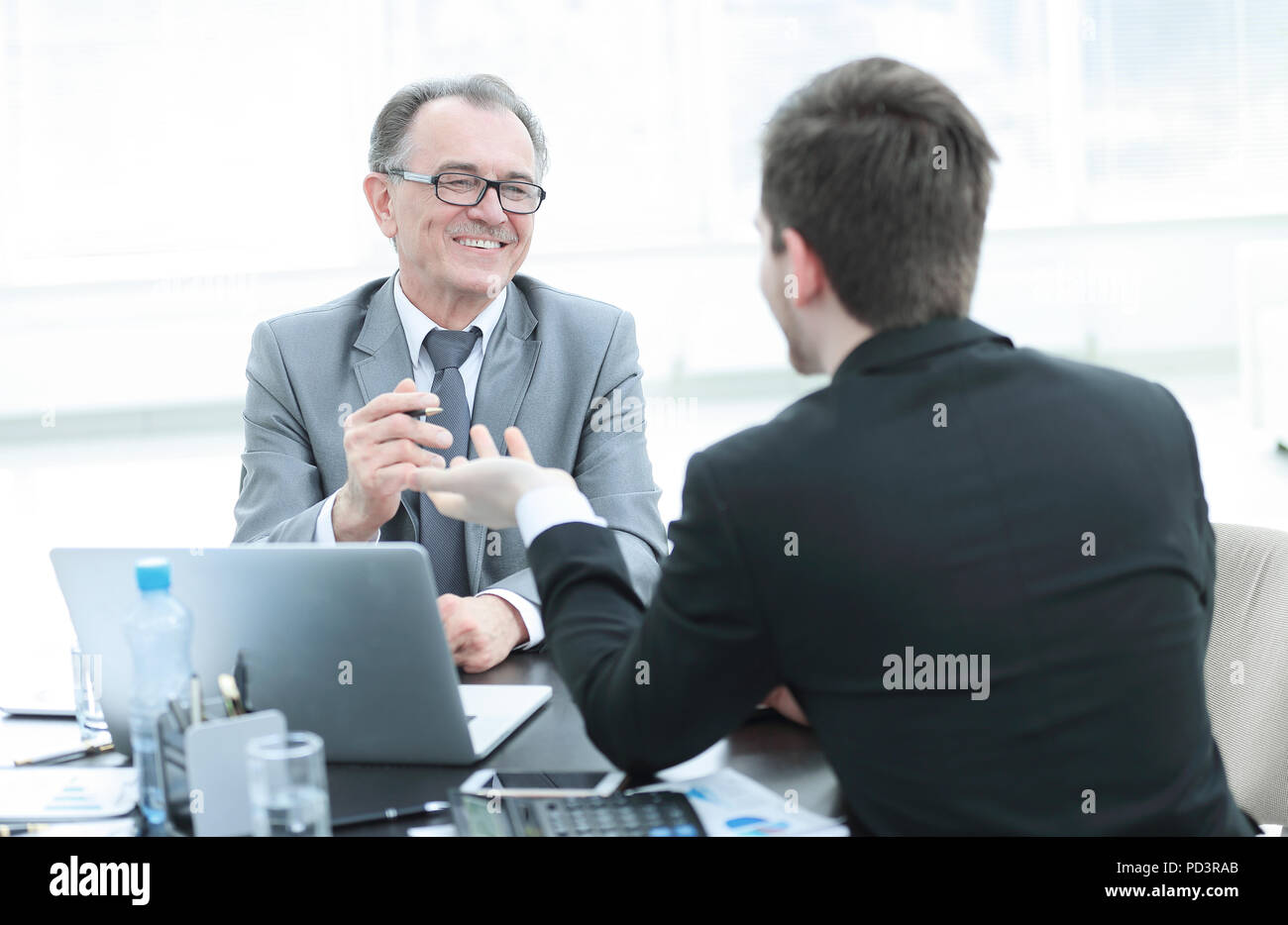 close up.business people talking at a Desk. - Stock Image