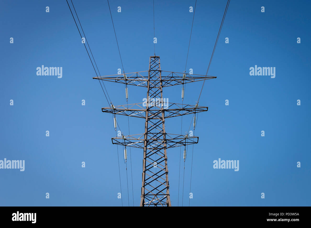electricity pylon with blue sky, - Stock Image