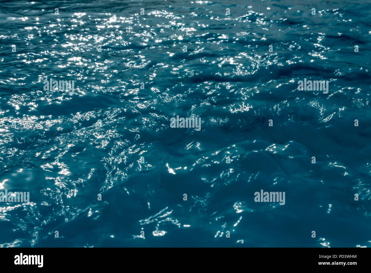 Water rippling with the sun's reflection shining on it, July 2018 - Stock Image