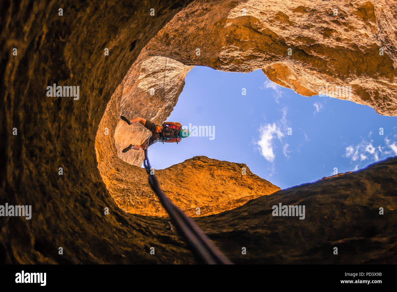 Man abseiling, low angle view, Smith Rock State Park, Terrebonne, Oregon, United States Stock Photo
