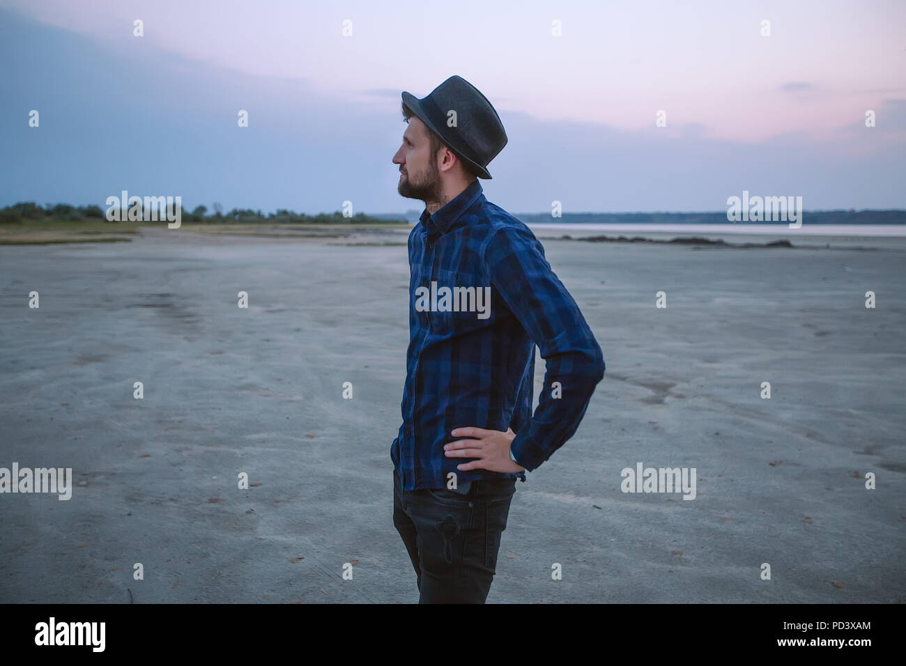 Man in hat on beach at sunset, Odessa, Ukraine - Stock Image
