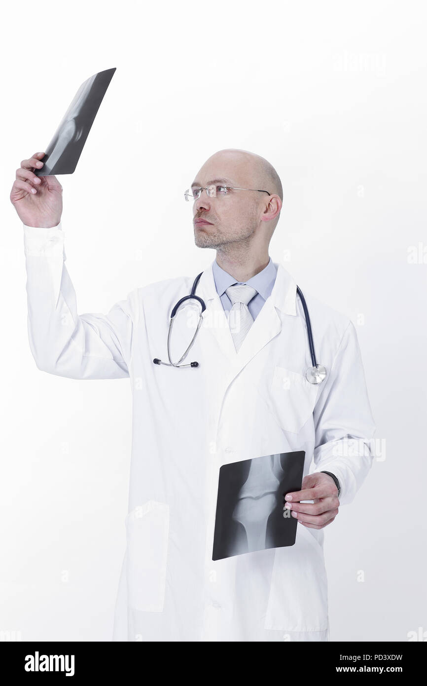 experienced therapist examining a radiograph of the patient - Stock Image