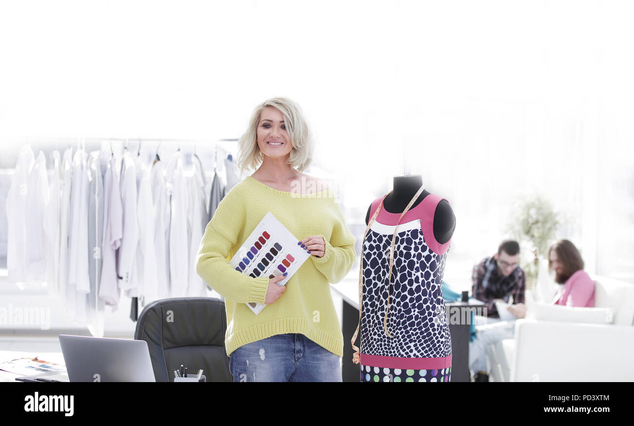 female fashion designer with the fabric samples for the new collection - Stock Image