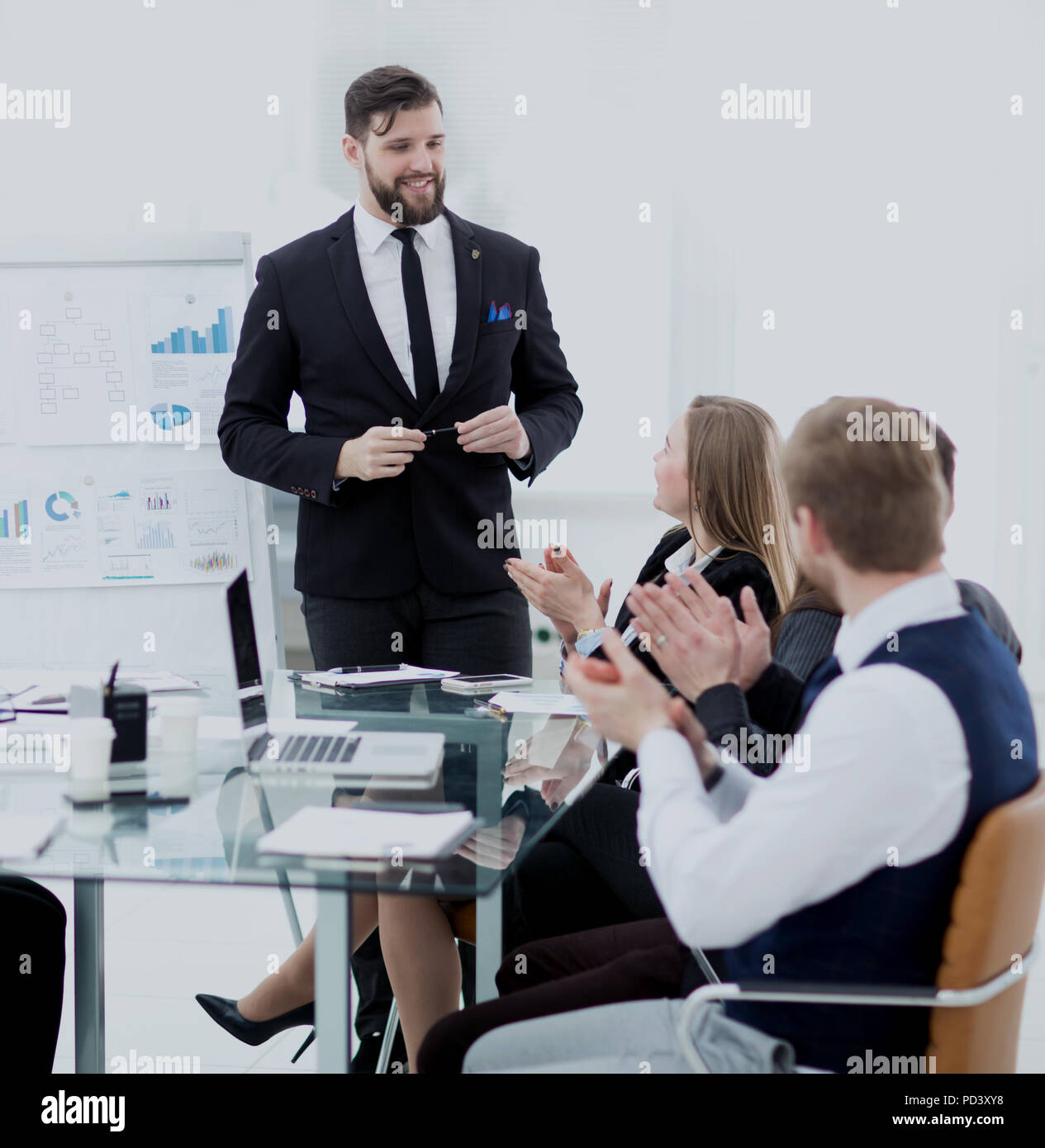 colleagues applaud the project Manager after the working meeting - Stock Image