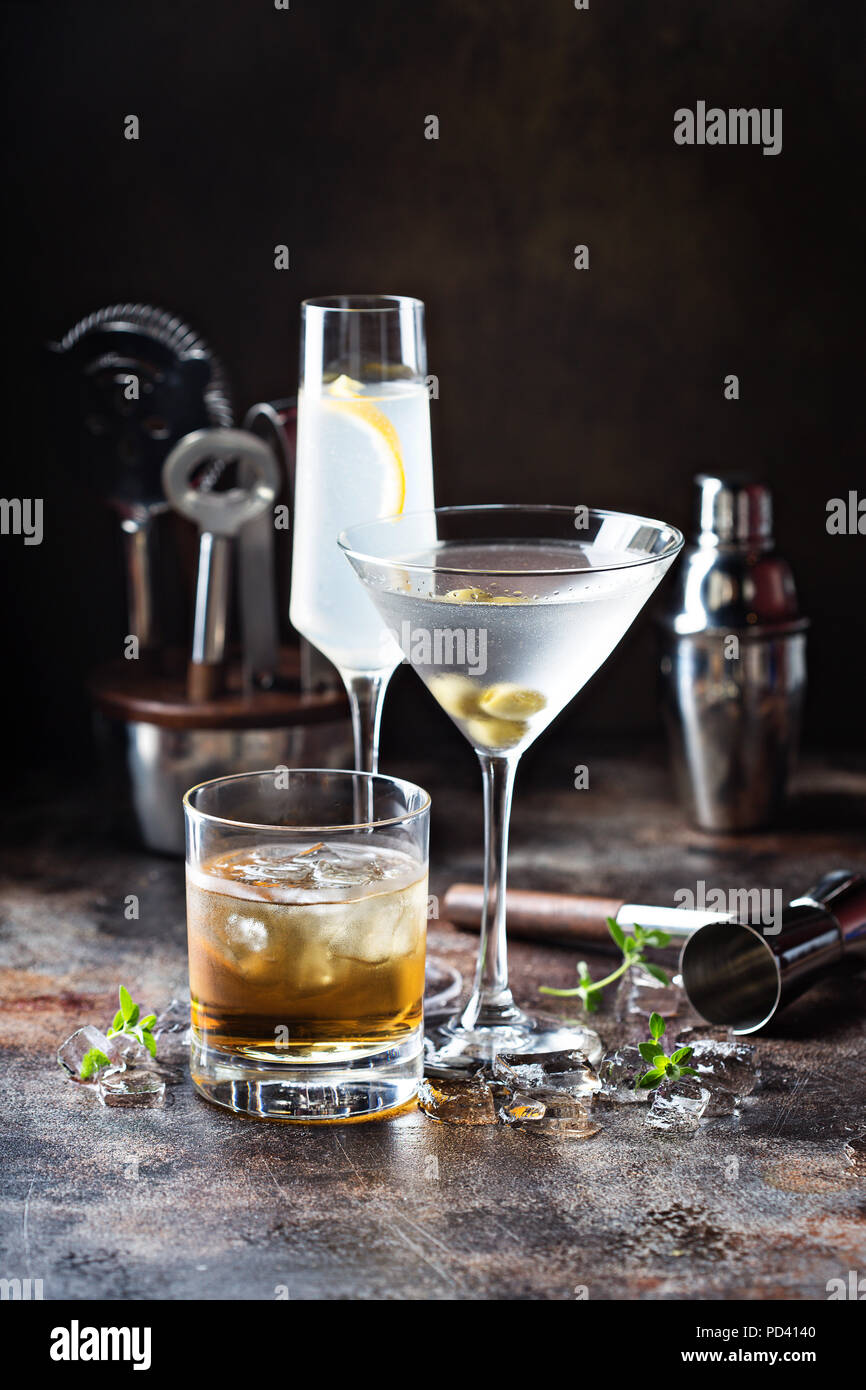Variety of alcoholic cocktails on dark background - Stock Image
