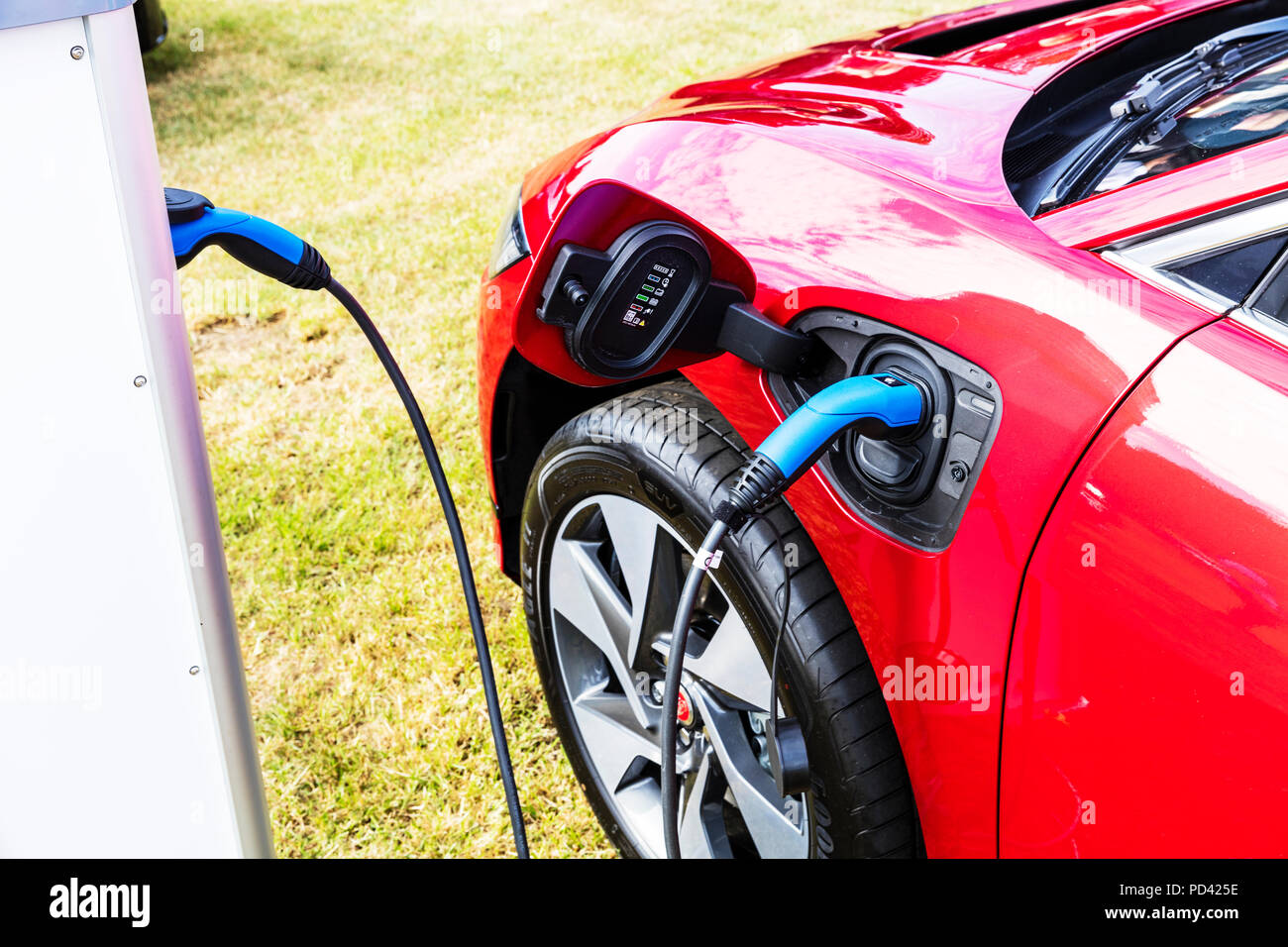 Battery Powered Car, Zero vehicle Emissions, Government Plug-In Car Grant, Plug-In Car Grant, Plug-In Car, electric charge point, electric car charge - Stock Image
