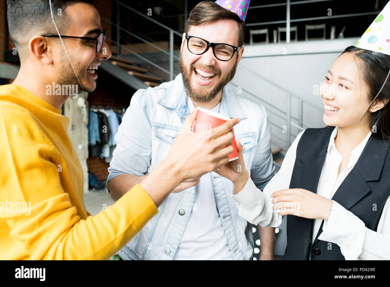 Celebrating Birthday in Office - Stock Image