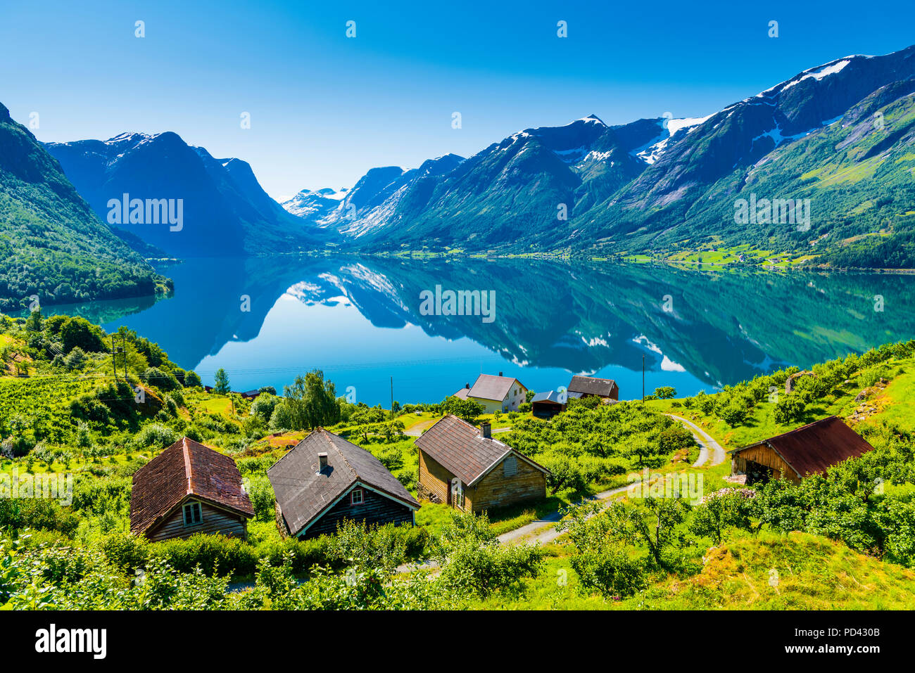 The small village Flo by the lake Oppstrynsvatnet in Western Norway - Stock Image