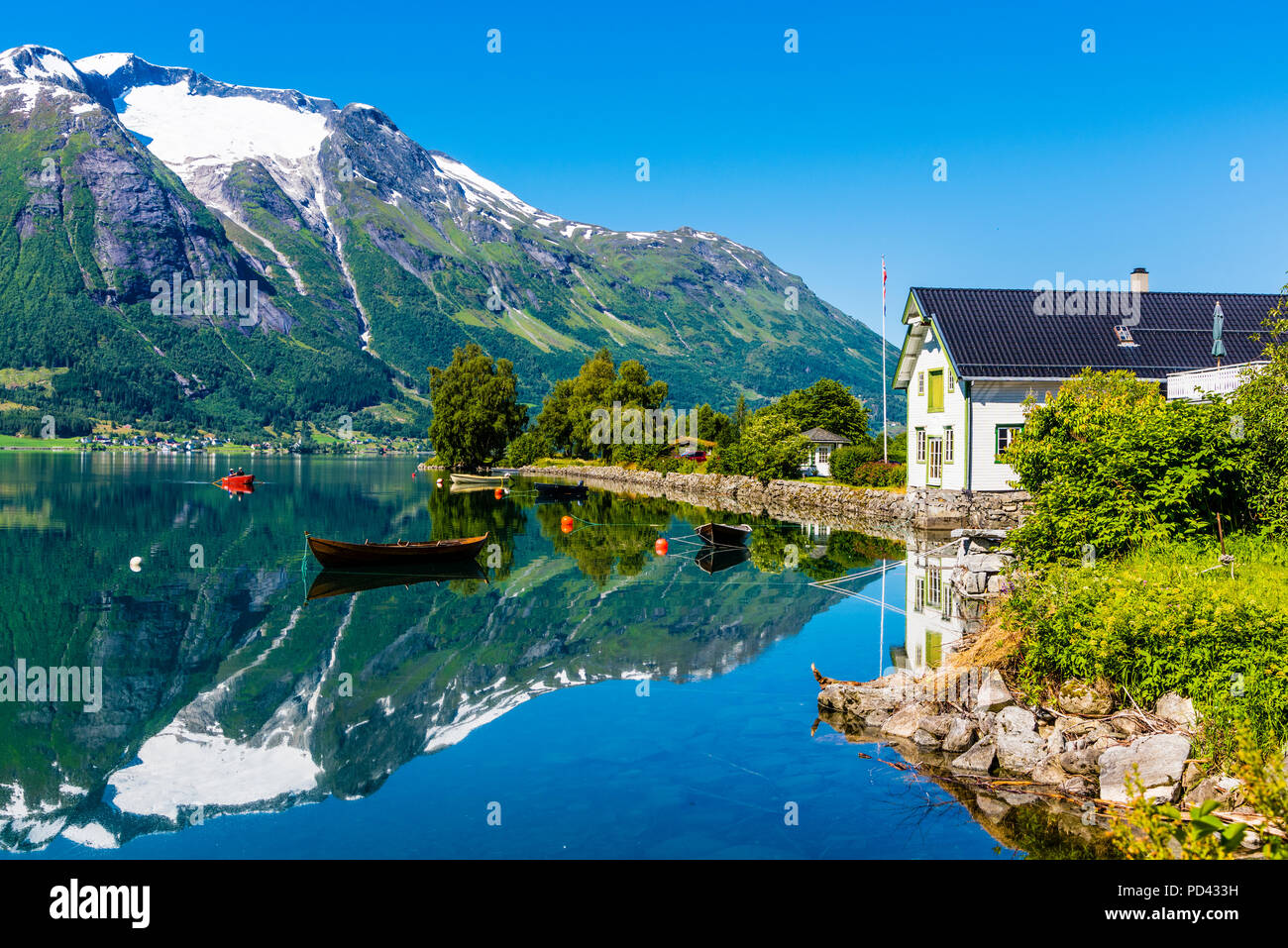 Hjelle, Western Norway, beautifully situated by the lake Oppstrynsvatnet. - Stock Image