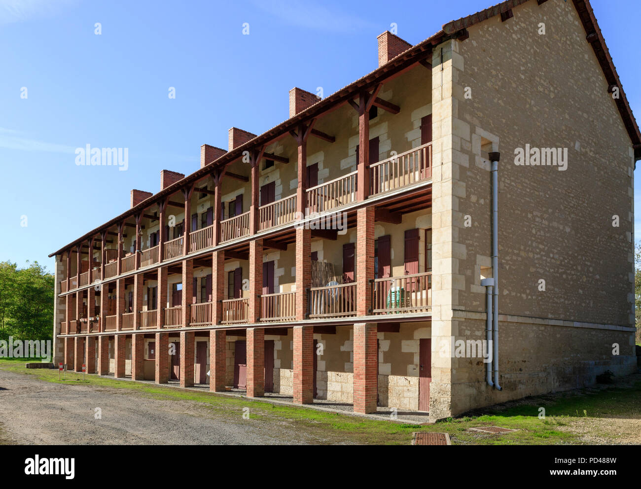 France, Cher, Berry, Grossouvre, Les Galleries building, labor housing of the 19th century // France, Cher (18), Berry, Grossouvre, immeuble Les Galer - Stock Image