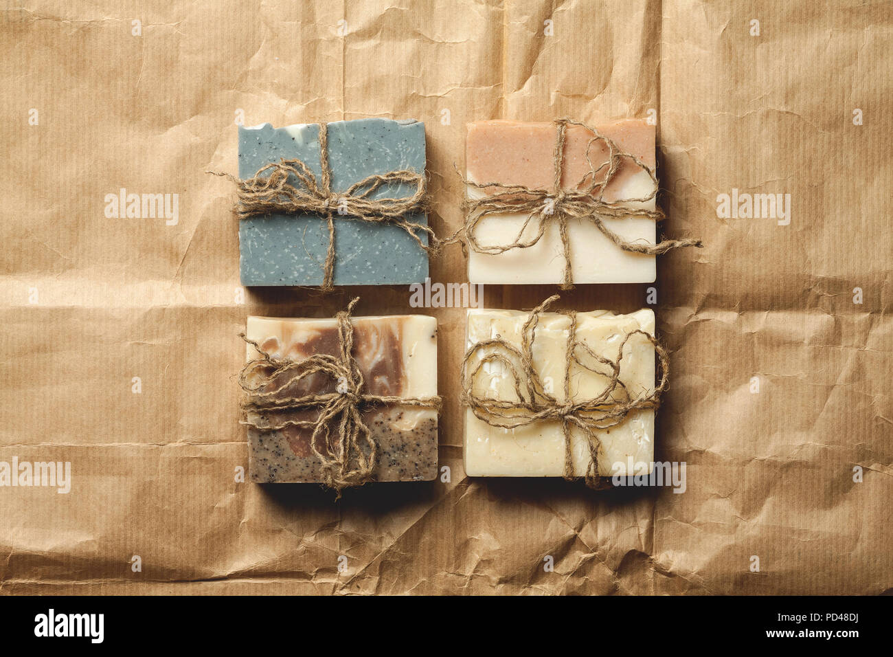 Organic handmade soap on packing paper. four slices - Stock Image