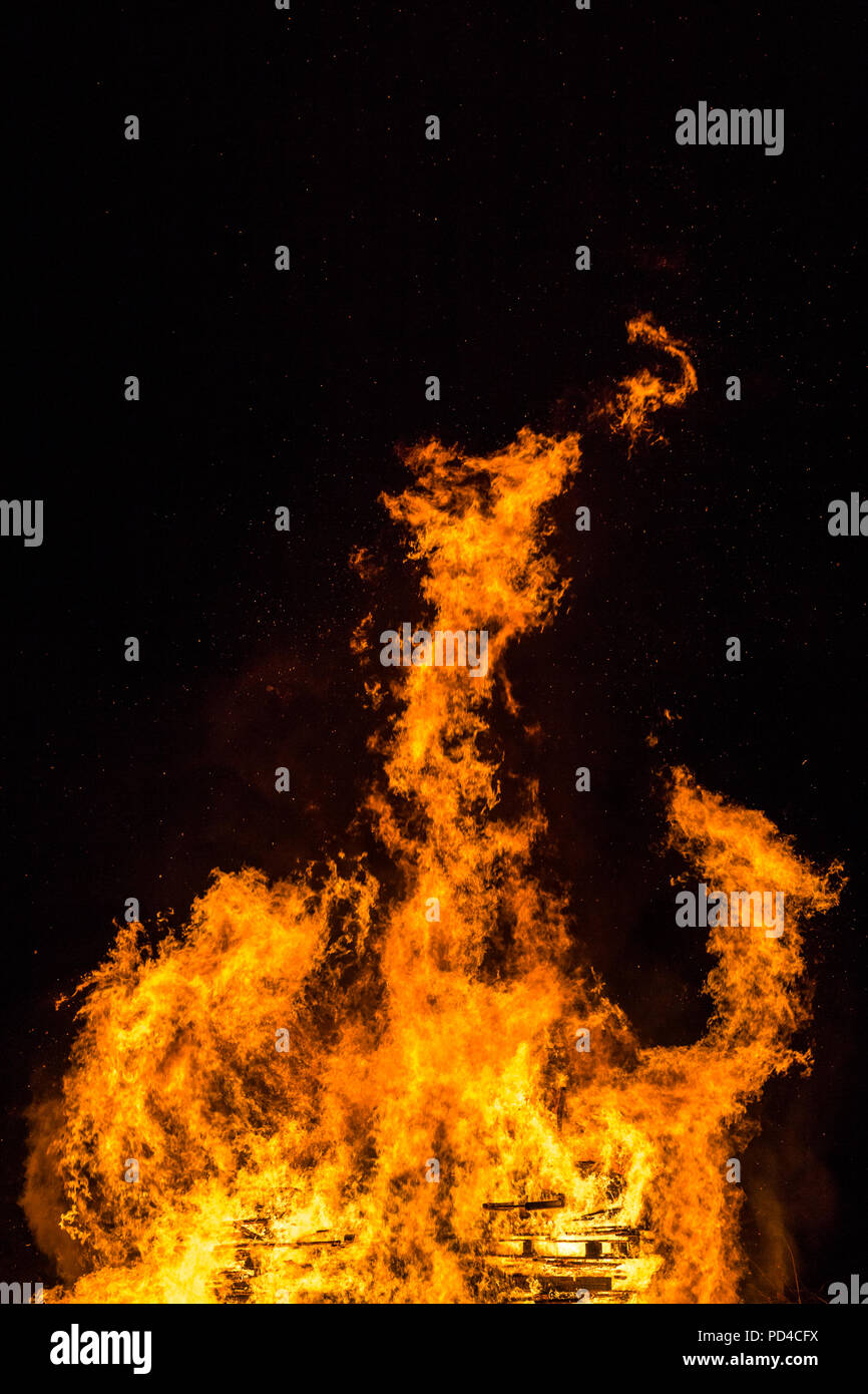Fire and flames with sparks and ember on black background - Stock Image